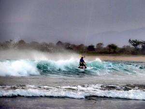 Seorang turis asing sedang berselancar di Pantai Lakey, Dompu, NTB. (Kandi)